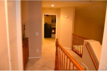 Upstairs hallway with open view to formal living and dinning roo