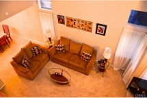 From upstairs enjoy the view of your formal living room and all