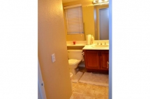 The guest bathroom downstairs is located next to the laundry roo