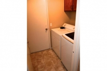 The laundry room is located directly off the family room leading