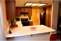 Enter the kitchen through the formal dinning room that leads to
