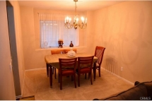 Formal dining room that flows through the spacious formal living