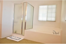 Master Bathroom with lots of natural lighting, stand up shower a