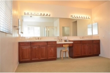 Master Bathroom with lots of natural lighting, dual sinks, and l