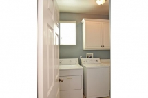 Spacious laundry room with lots of storage space, lots of natura