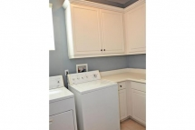 Spacious laundry room with lots of storage space, and natural li