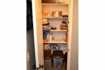 Cleaning supplies / Storage closet located conveineintly in the