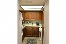 Cozy kitchen with lots of counter top and cabinet space with bea